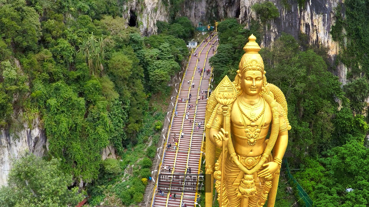 TThe golden sight that greeted us at Batu Caves Hindu Temple, filmed from the air with our UAS