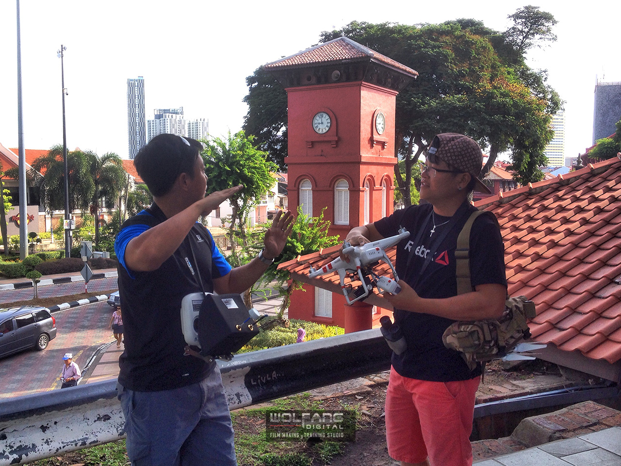 The aerial videography team formulating a flight plan for a low altitude aerial over Malacca town