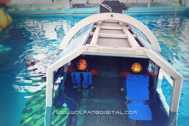 The simulator will execute a 360 degree roll underwater to imitate a capsized craft.