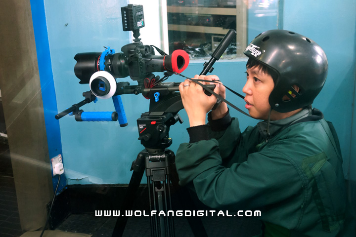 Film Director Baron prepping the Canon 7D right outside the freefall simulator