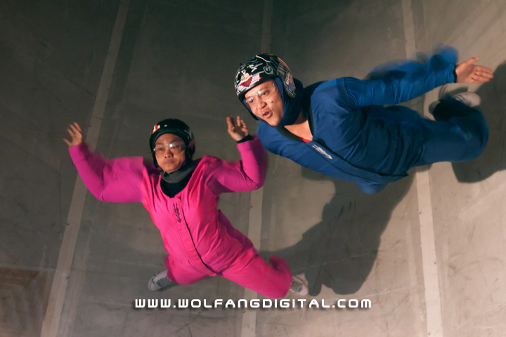 Two instructors showing off their skills in the wind tunnel. In the pink jumpsuit is a highly experienced lady instructor