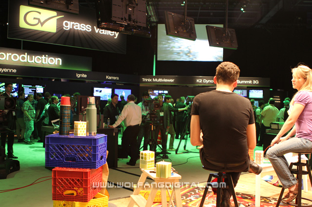 General overview of Grass Valley's booth from behind the live set.