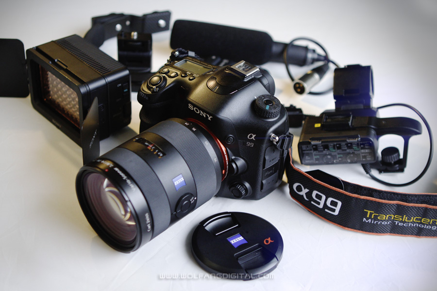 Sony A99 DSLT with Zeiss 24-70mm F2.8, XLR adapter, battery video light and shotgun microphone.