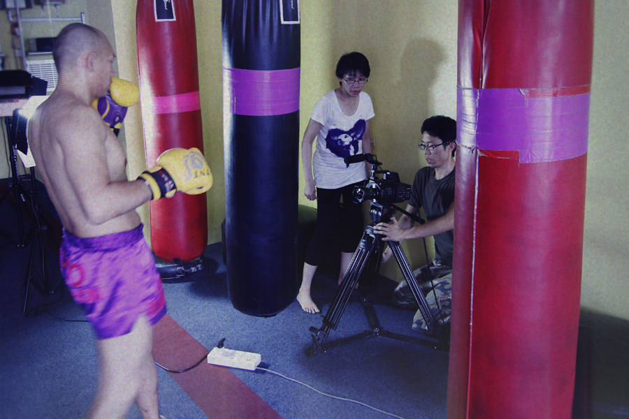 Our film director, Pureen and Ma setting up the shot of Master Khoo doing his warm-ups.