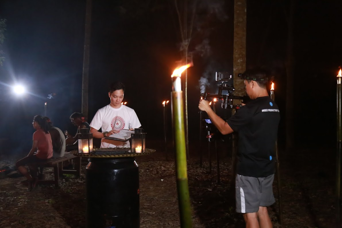 The AX100 filming at night on a DJI Ronin stabilizer filming Jeremy Teo, the host of Kampung Quest.