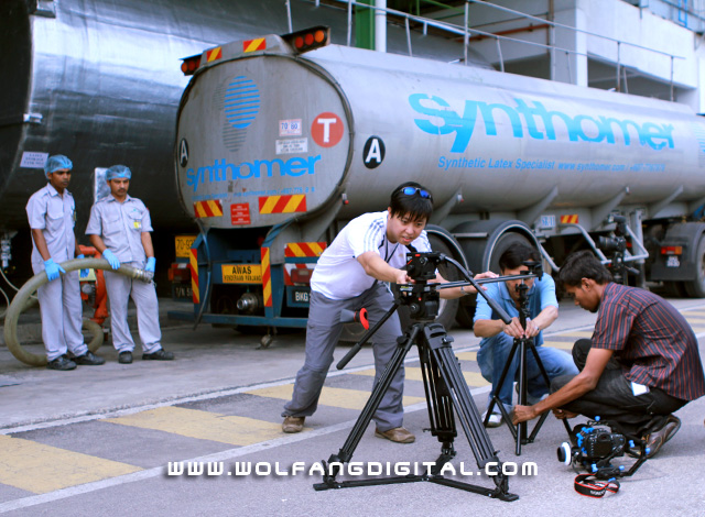 Latex bounty. Our team gears up to film workers unloading a tanker ferrying raw material