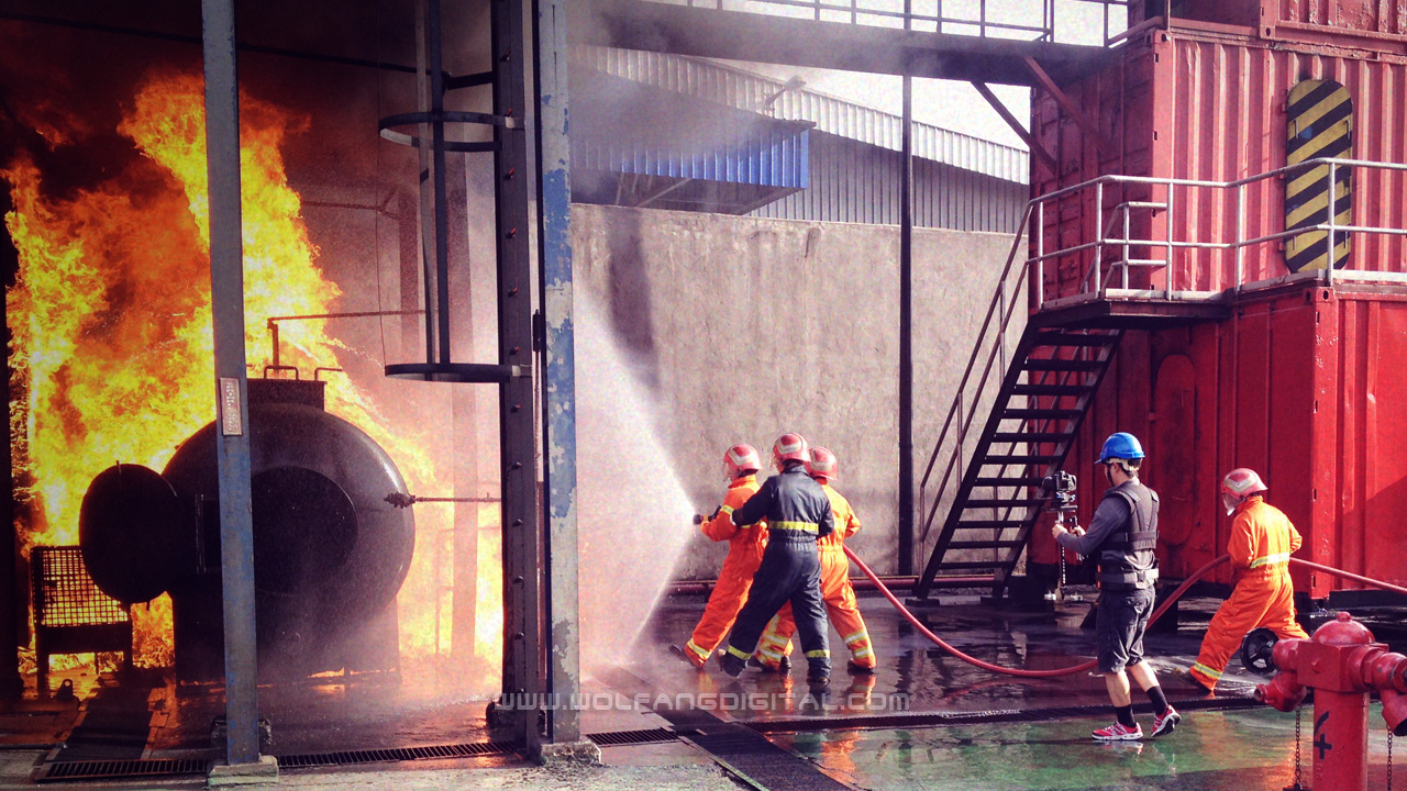 WolFang Digital team using a Glidecam stabilizer to film a firefighting scene for MSTS Asia corporate video.