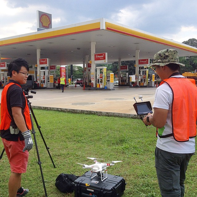 We are up once talents and vehicles are in position. Fuel station #aerialfilming #safety first #knowbeforeyoufly #dronelife #dronevideo #aerialvideo #filmmaking