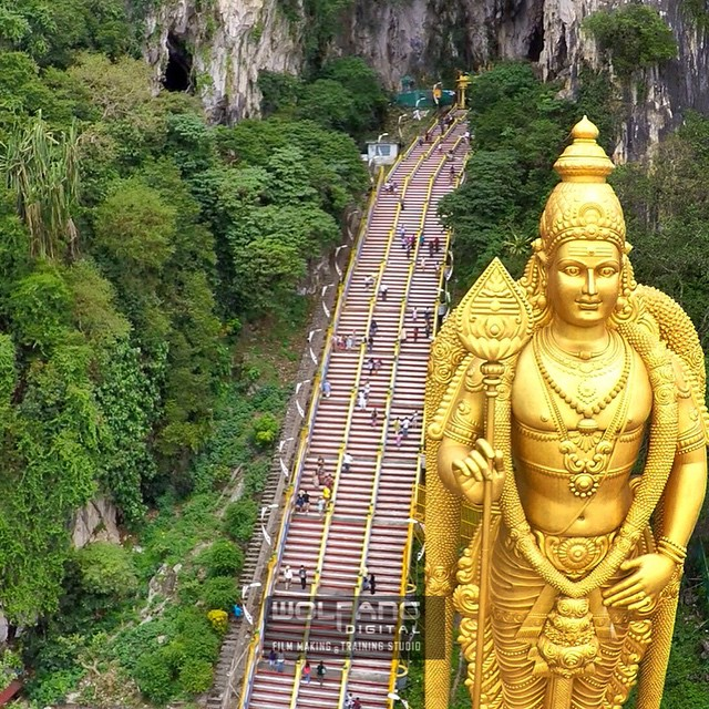 The 2nd tallest statue in the world of a Hindu deity. From the city we arrived at Batu Caves for aerial filming of Dutch reality show Peking Express #aerialfilming #dronelife #filmmaking #onlocation #aerialvideo #dronestagram #phantom2 #djimoment #goprohero4 #goprouniverse #hero4 #batucaves #dji #malaysia  WWW.WOLFANGDIGITAL.COM